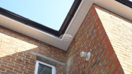 White UPVC tongue and groove soffit black guttering