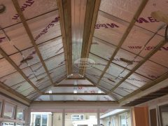 Solid conservatory roof installation showing insulation