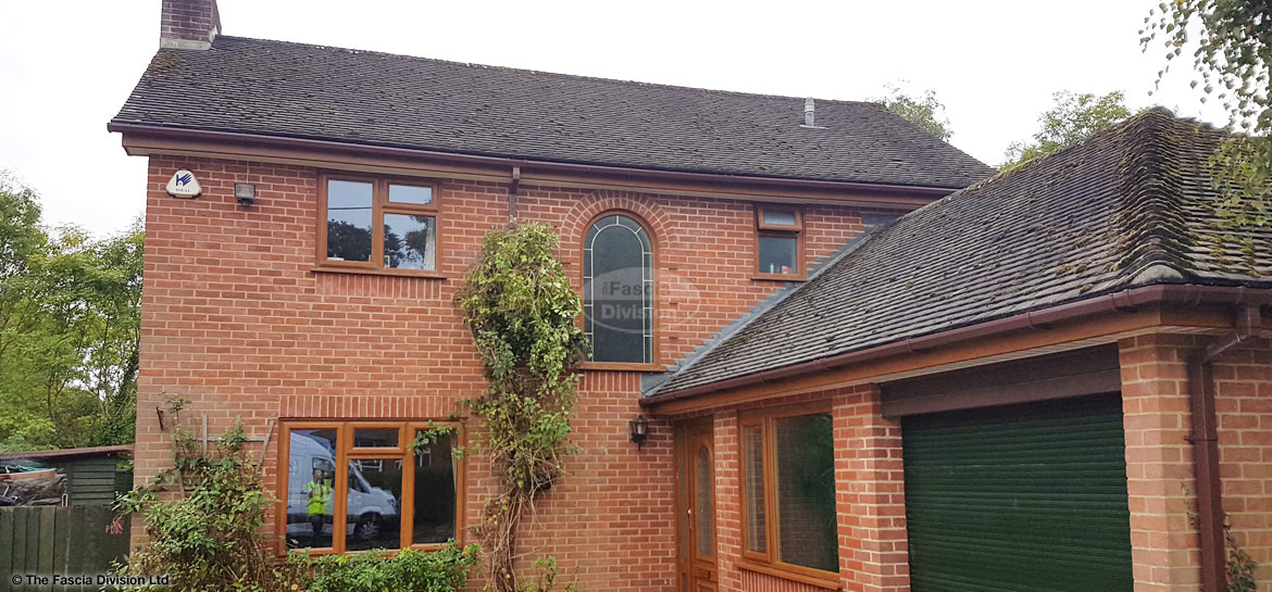 Oask fascias and white soffits