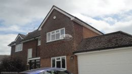 UPVC white fascias, soffits and black UPVC half-round guttering installation in Penn, High Wycombe