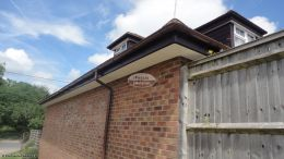 Installation of rosewood fascias white tongue and groove soffits and brown half round guttering Widmer End High Wycombe