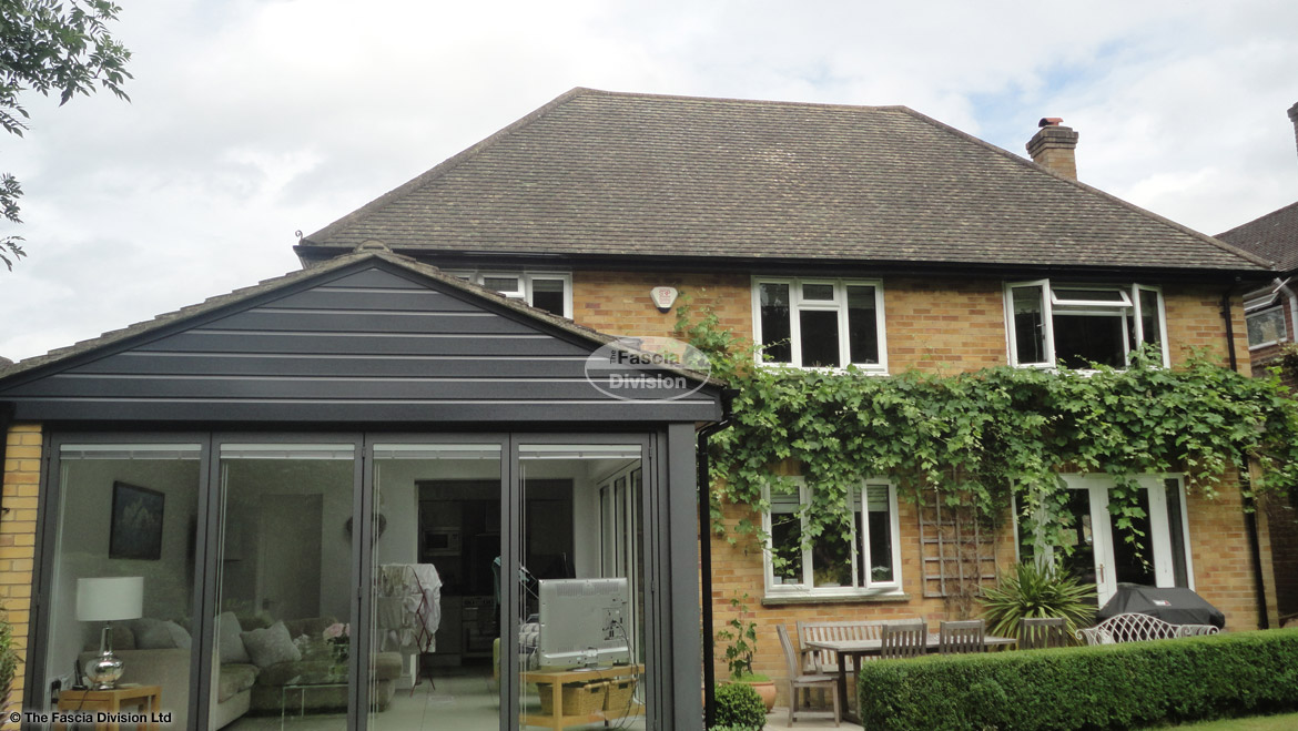 Recent installation of anthracite grey UPVC shiplap cladding fascias soffits and black half round guttering on a detached property Maidenhead High Wycombe