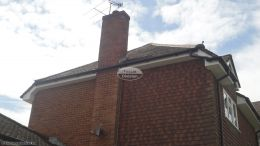 white UPVC fascias, soffits and black half-round guttering in Penn, High wycombe
