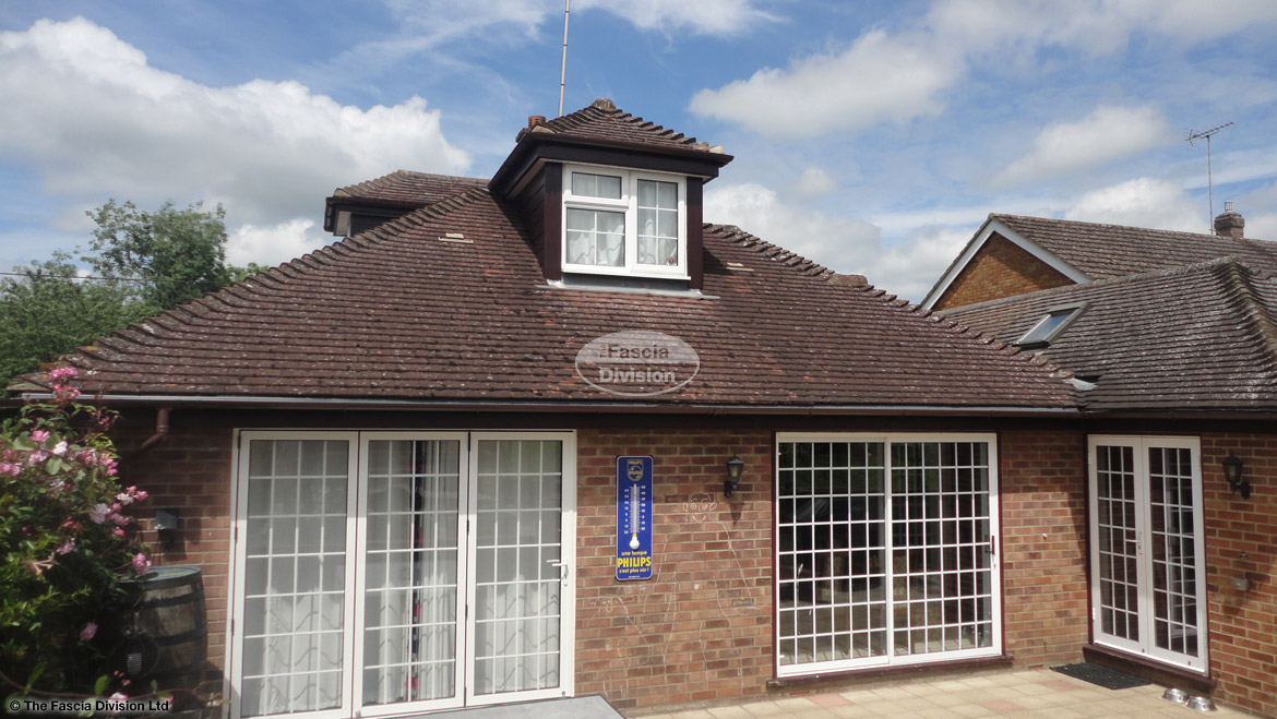 Replacement rosewood fascia soffit and guttering with shiplap cladding on window dormer at rear of detached bungalow Widmer End High Wycombe