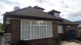 Replacement rosewood fascia soffit and guttering with shiplap cladding on window dormer in Widmer End High Wycombe