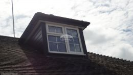 Replacement rosewood shiplap cladding on a window dormer on a detached bungalow Widmer End High Wycombe