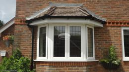 New UPVC White around lower elevation window with standard fascia board and tongue and groove soffit Penn High Wycombe