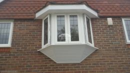 New UPVC White shiplap cladding around window with standard fascia board and tongue and groove soffit Penn High Wycombe