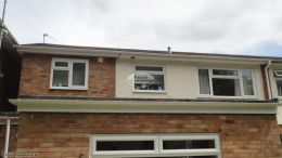 Recent full replacement UPVC white fascias soffits and black half round guttering rear of property Penn High Wycombe