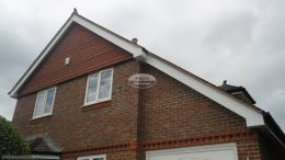 Recent white upvc full replacement fascias tongue and groove soffits in white UPVC with black guttering Penn High Wycombe