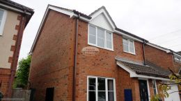 UPVC white herringbone cladding white upvc fascias soffits brown square guttering