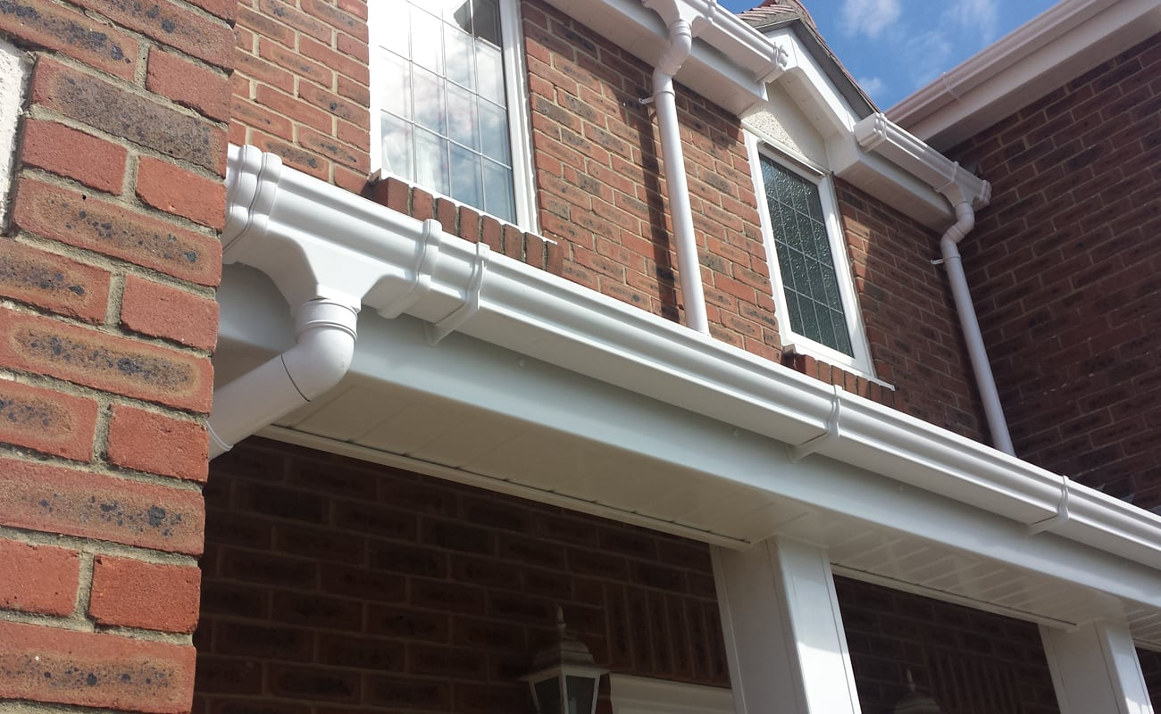 White ogee guttering with white fascia and soffit