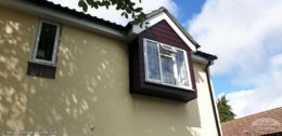 Rosewood PVC cladding on a dormer window
